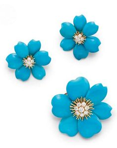 A SET OF TURQUOISE AND DIAMOND JEWELRY, BY VAN CLEEF & ARPELS  Comprising a flower brooch, set with a circular-cut diamond cluster with gold detail, extending turquoise petals; and a pair of ear clips en suite, mounted in 18k gold, with French assay marks and jeweler's marks for Van Cleef & Arpels All signed V.C.A. for Van Cleef & Arpels, nos. NY1K34-25 and NY3K908-15