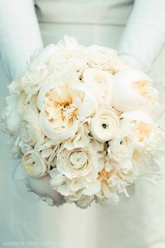White bouquet! Looks like there is some ranunculus and peonies in there www.cabofloralstudio.com