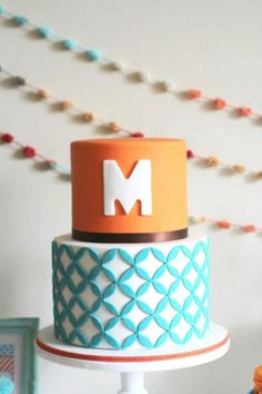 """geometric cake   the """"maddox cake"""" -instead of M, have it as B for new married last name initial. =)"""
