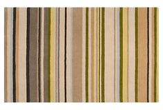 This rug has greens and beach colors - a nice combination of earth tones with beachy sands and blues.