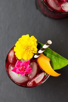 Tropical wedding cocktail idea - Dark and stormy cocktail with fun straw and fresh flowers {Courtesy of Sugar & Cloth}