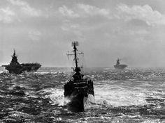 Destroyer English DD679 in center, Hancock CV19 on left and Enterprise CV6 on the right. Jan 1945.