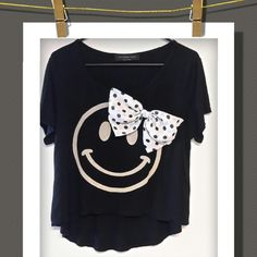 ✴Top✴ Adorable high-low top with a Smiley face and a polka dot bow. Made in USA .... 100%Rayon The-Classic Tops Tees - Short Sleeve