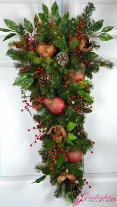 Williamsburg Christmas Wreath with red pears and dried materials by Gaslight Floral Design. GaslightFloralDesign.com