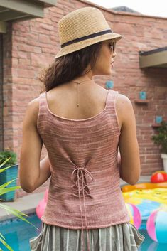 Get your summer lace on with the beautiful and breezy Seashell Tank knitting pattern by Heather Zoppetti. A floral front lace panel and an I-cord drawstring threaded through crochet loops in the back give the top a romantic, ethereal aesthetic.