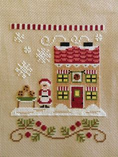 completed cross stitch Country Cottage Needleworks Christmas Mrs Claus' Cookie