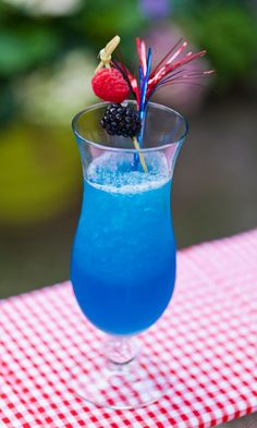 1½ oz. white rum 1 oz. blue curacao 3 oz. Lemonade Sparkling ICE Garnish: blueberries