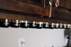 Under the cabinet mounted magnetic Spice Rack Tutorial. (You can also mount an old cookie sheet under the cabinet to stick the spice jars to, just make sure it's magnetic)