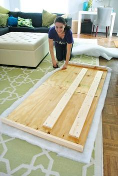 How to make an upholstered headboard. It's super easy. I've done this in our guest room, it isn't that hard (my husband helped though) :)