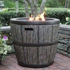This Rustic Wine Barrel Fire Table will enhance any outdoor living space. Crafted from durable concrete based composite material and Powder Coated Interior Steel Frame this Wine Barrel Fire Table will stand up to the elements. Outdoor Fire Pit Table, Gas Fire Table, Outdoor Living, Outdoor Tables, Outdoor Life, Outdoor Spaces, Wine Barrel Table, Wine Barrel Fire Pit, Gardens