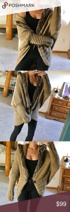 the ••oversized cozy•• beautiful, cozy, amazing, oversized, front hook, chunky cardigan to keep anyone warm this winter! ⛄️❄️ faux fur hood, and faux fur lining down the front. This will fit any size! Worn once. It's like new. ASOS Sweaters Cardigans