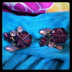"""Vintage Amethyst Rhinestone Earrings Vintage Gold tone Beau Jewel clip earrings. Huge purple glass hexagon with purple and lavender rounds and navette rhinestones. They measure 1.25"""" x 1"""" and are hallmarked BEAUJEWELS. Great condition. Vintage Jewelry Earrings"""