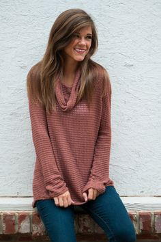 """This beautiful brown piece could be a long time love if you snatch one up before they're all gone! In a stunning, unique color that can easily be style, this thin sweater is just the thing for fall layering! <br /> <br />Bra-friendly! Material has generous amount of stretch. <br />Miranda is wearing the small. <br /> <br />Length from shoulder to hem: S- 30""""; M- 31""""; L- 32""""."""
