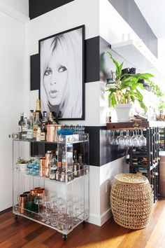 black and white striped wall, acrylic bar cart, black and white photo, copper bar accessories, love.