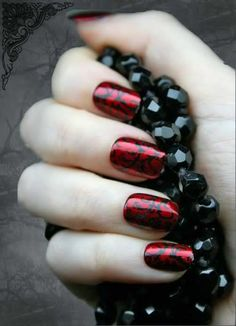 beautiful garnet red with black design....gameday nails?