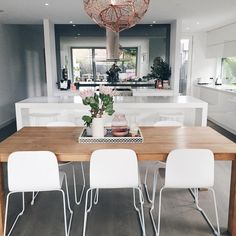 """""""Back by popular demand, the front on view of my kitchen. The full height smoked mirror splashback makes the space feel huge and reflects the outside…"""""""