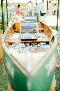 Beautiful way to store drinks for an outdoor wedding and also create a feature in the decor - an old boat! From Wedding Bells