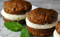 Sweet, decadent maple cream cheese frosting is sandwiched between two fluffy pumpkin cakes.