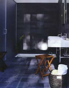 grey stone bathroom with sunken tub. Minimalistic and earthy