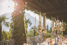 Tall floral candles. Design by The Lake Como Wedding Planner #lakecomo #wedding #weddingplanner