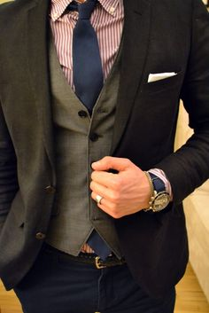 Red & white striped shirt, navy tie, gray blazer, gray vest. #men #style #fashion