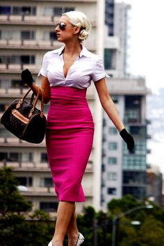Another high-waisted pencil skirt--this one in eye-popping pink, topped with a short-sleeved showy button-front blouse and short black gloves.  Per...fect!