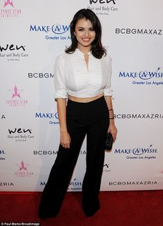 Monochrome: The singer flashed her midriff in a black-and-white ensemble