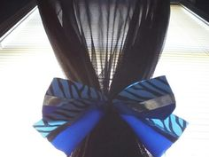 I used my old cheerleading bows for my curtains.
