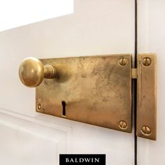 Our Horizontal Rim Lock in Vintage Brass adds a rustic look to this creole style home. Credit: J. Schram Architect Our Horizontal Rim Lock in Vintage Brass adds a rustic look to this creole style home. Credit: J. Home Design, Home Interior, Interior Design, Baldwin Hardware, Home Hardware, Entry Door Hardware, Window Hardware, Vintage Design, Vintage Style