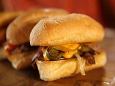 Pawhuska CHEESESTEAKs Layered savory roast beef, butter-cooked peppers & onions...the ultimate sandwich!