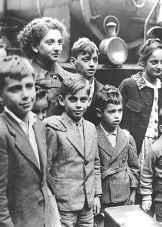 Lisbon, Portugal, 1941, Jewish children who were smuggled from occupied France, standing beside a train.