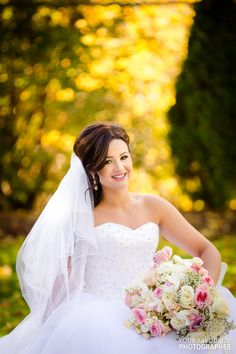 Beautiful brunette bride posing with bouquet in front of autumn colours Brunette Bride, Bride Poses, Autumn Colours, Party Photos, Formal Wedding, Looking Stunning, Banquet, Garden Wedding, Wedding Photography