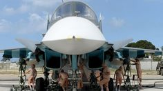 Russian servicemen prepare an SU-34 fighter jet for a mission from the Russian Hmeimim military base in Latakia province, in the northwest of Syria on May 4 2016
