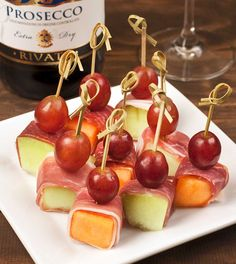 Prosciutto-Wrapped Melon: Prosciutto-wrapped melon chunks are an easy, no-cook appetizer that everyone adores. Top with a grape and skewer with a pick for a great-looking presentation.