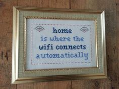 'Home is where the WiFi connects automatically' cross stitch sampler in frame ($55)