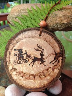 Santa Claus pyrography wood burned ornament created by Sandy Blanc for sale on Etsy.