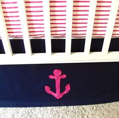 Custom crib skirt with anchor appliqué! Love pink and navy for a little girls nautical room.