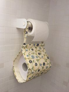 New toilet paper roll holder to be inserted directly into the slot of your bathroom. Handcrafted in double layer, patterned cotton outside, only color inside. Made to order in other fantasies.