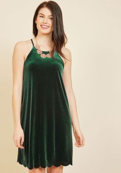 Caroling Karaoke Velvet Dress | Mod Retro Vintage Dresses | ModCloth.com  The lyrics are up and you're in your happy place - you're singing your heart out in this emerald green shift dress! Making you the life of the party, this simple frock features a high neckline, a scalloped hem, and an easy fit - perfect for dancing along to your favorite festive tunes.