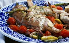 main pic smaller whole baked fish + origanum + lemon + olives + tomatoes = mediterranean feast Fish Recipes, Seafood Recipes, Healthy Recipes, Healthy Food, South African Recipes, Baked Fish, Baking Tins, Seafood Dishes, Mediterranean Recipes