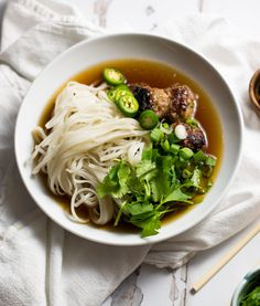 Vietnamese meatball pho noodle soup (pho bo) is a comforting way to warm you up this winter. The meatballs set this pho apart and are super flavorful!