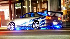 Nissan Skyline R34 GT-R - minus the graphics and neons. Ew.