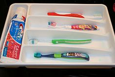 Brilliant! What a great idea to keep the kids toothbrushes separated while keeping your drawer clean  tidy... easy to wipe out when needed.