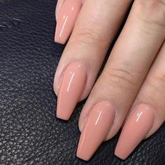 Peach nails in perfect shapes