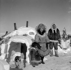 people of the world: Inuit family outside igloo [Left to Right:  possibly Naikak, Noanikhok and Nokadlak]. (item 1)