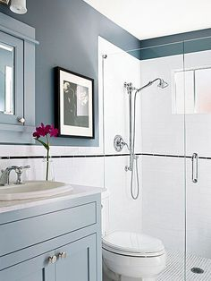 This once-outdated small bathroom gets a big style boost thanks to a handful of traditional touches. White subway tile along the bottom half of the wall and in the shower surround reflect years gone by. Shimmering chrome fixtures throughout the room add sparkle and elegance.
