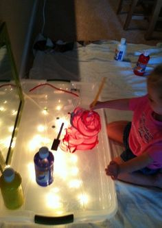 Discoveries with the light table. Shaving cream and paint.