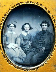 You big lug, pull in your legs so your sisters have room! He is big and I think a good natured tease, but the girls have learned to put up with him. Loving siblings...1850s.