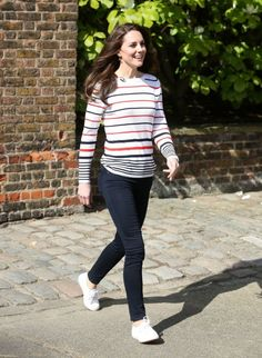 For a reception with the marathon runners from Team Heads Together, Kate wore skinny jeans, white plimsoles and a striped jumper.<br /><em>[Photo: PA]</em>