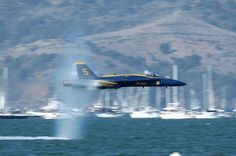 F-18 Blue Angel breaking sound barrier just feet over the bay